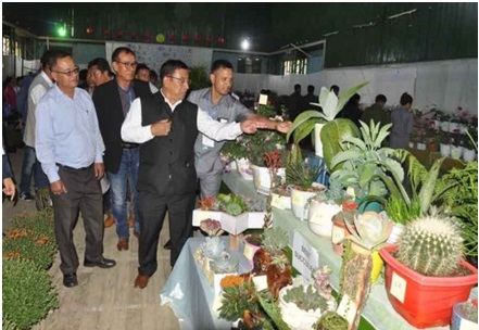 Minister Thounaojam Shyamkumar inspects flower during Annual Ukhrul Flower Festival